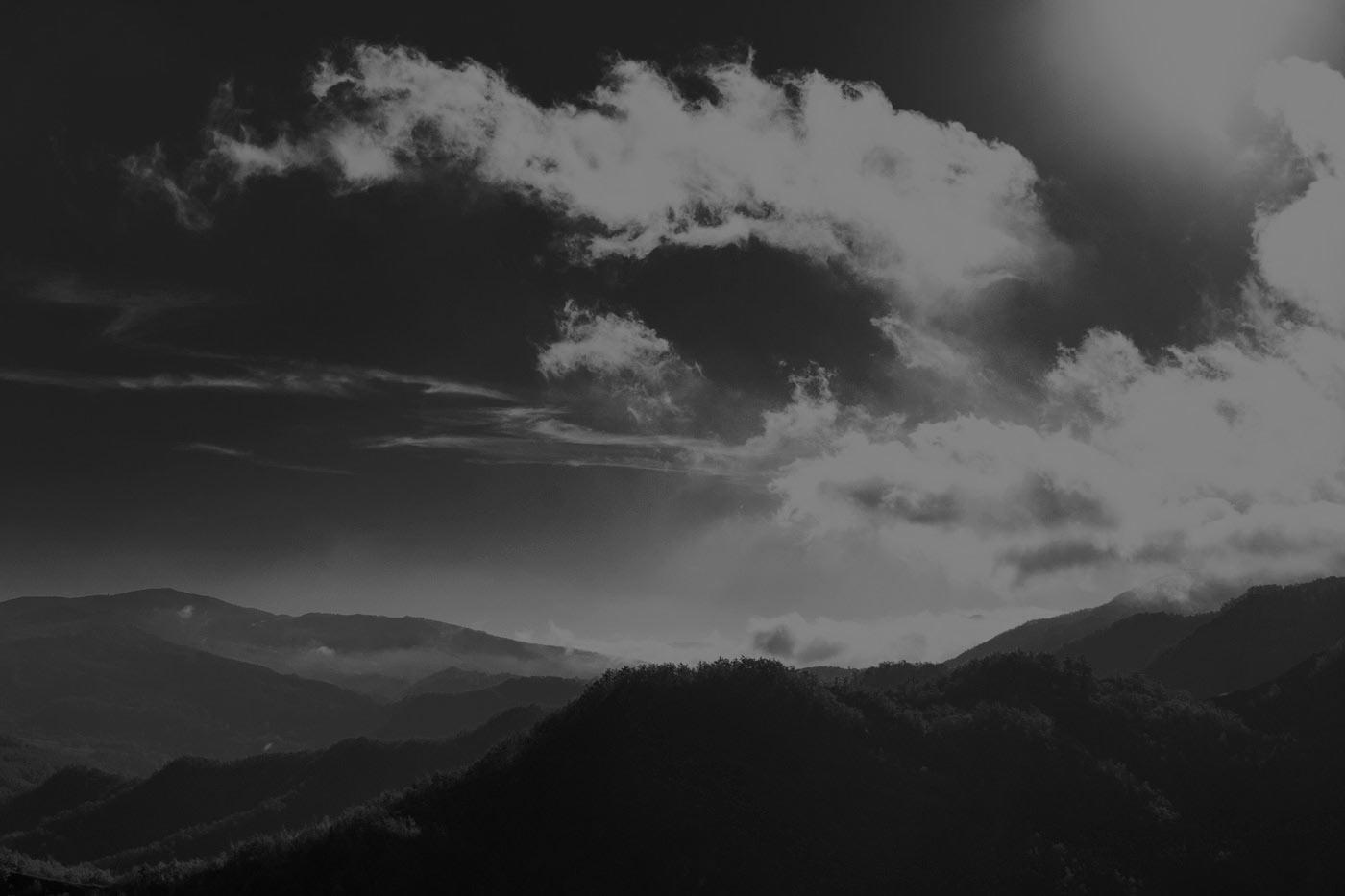 darkened cloudy hills